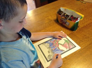 My son coloring a colAR sheet